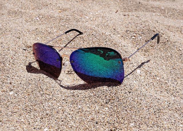 sun glasses on the sand